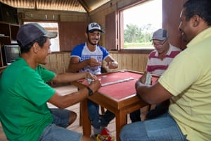 Seringueiros playing dominoes at lunchtime.