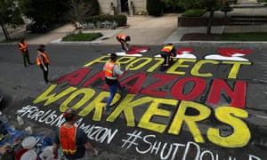 Activists paint a sign for Amazon.com Inc founder Jeff Bezos in Washington on 29 April 2020.