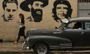 A mural in Havana depicting (L-R) Cuban Comunist party founder Julio Antonio Mella and revolutionary leaders Camilo Cienfuegos and Che Guevara.