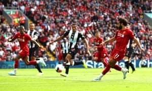 Mohamed Salah of Liverpool scores his team's third goal.