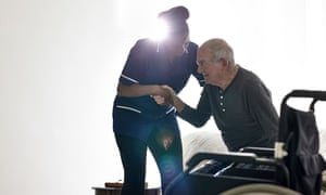 Elderly man at home with carer