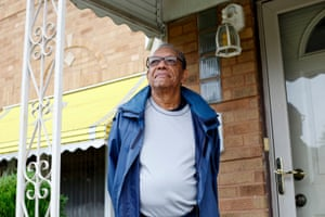 Tim Pegues on the front porch of his home in Chicago.