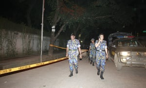 Bangladeshi police at = site where Cesare Tavella was shot dead   in Dhaka