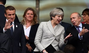 Theresa May with interior minister Gérard Collomb and President Macron