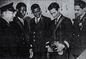 Four newly hired people of colour – (from second left) Norris Edwards, Norman Samuels, Abbas Ali and Mohammed Rashid – are trained by Frank Mills, a ticket inspector, after the abolition of Bristol Omnibus Company's colour bar.