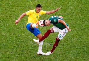 Brazil's Casemiro and Mexico's Hector Herrera go for the ball.