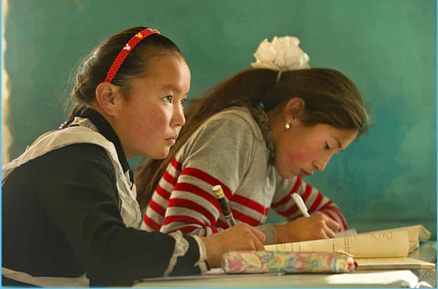 High-flier … Aisholpan, left, at her school studies; she wants to be a doctor.
