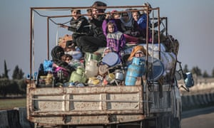 Syrian families flee homes