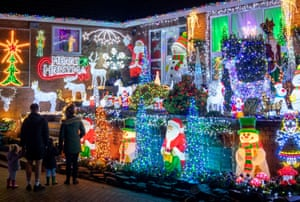 The house of Helen and John Attlesey in Soham, Cambridgeshire, has been decorated with hundreds of Christmas lights