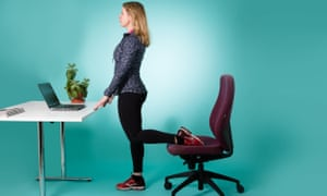 woman doing lunges at desk
