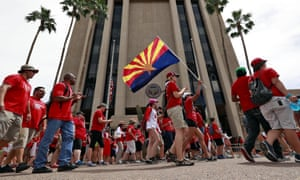 Teachers in Arizona rally outside the office of the governor. Thousands have walked out across the nation in protest of low pay and poor school funding.