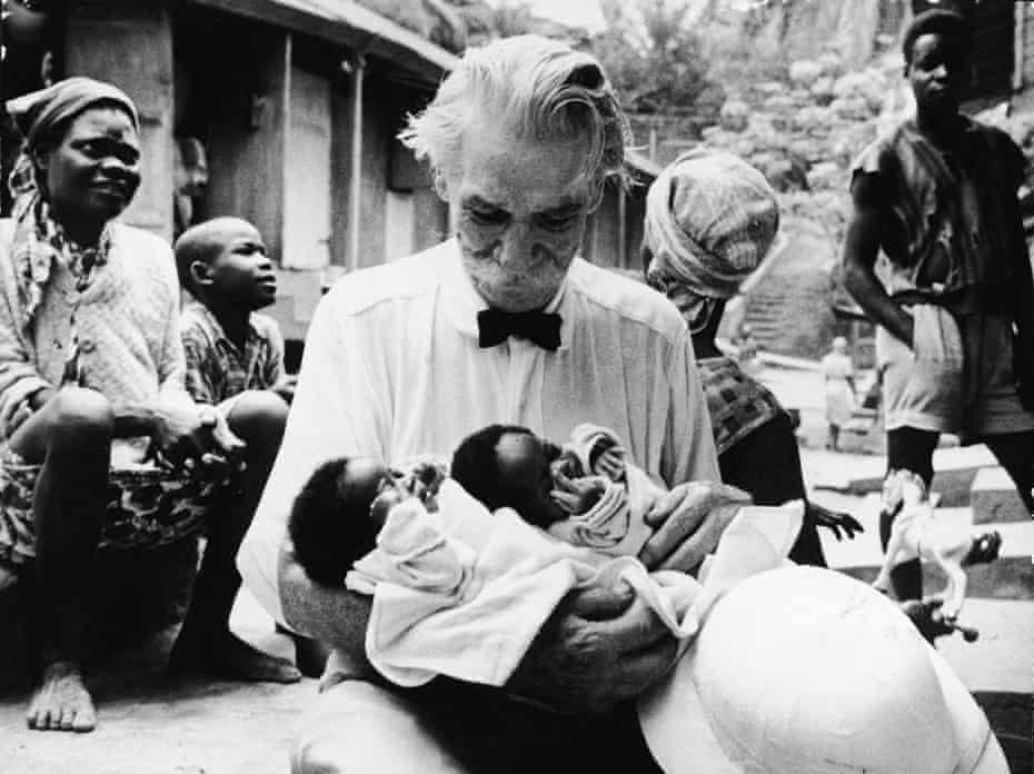 Dr Albert Schweitzer cradles two babies at the hospital he founded in Lambaréné, part of French Equatorial Africa (now Gabon).