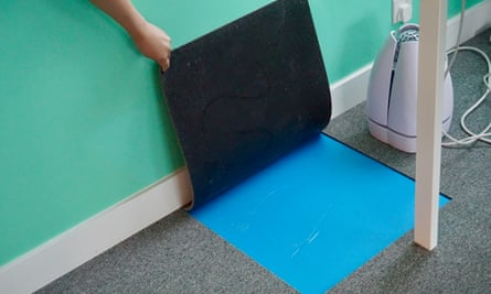A feng shui sticker under the carpet at M.int Academy, placed to boost good energy flowing through the business.