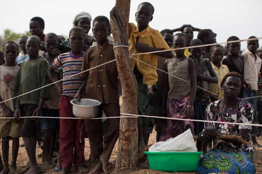 South Sudanese children wait as the WFP prepares to deliver food aid at the Bidi Bidi refugee camp in Arua, Uganda.