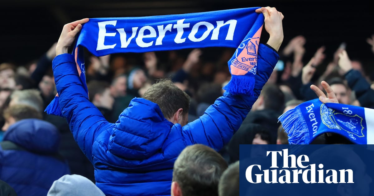 Everton director of football Marcel Brands wards off angry fans at training