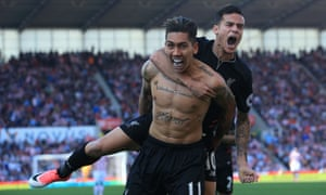 Roberto Firmino celebrates scoring Liverpool's second goal with Philippe Coutinho.