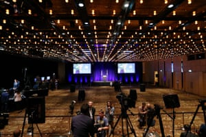 As the vote counting gets underway, media await an announcement at the Liberal party function at the Sofitel in Sydney.