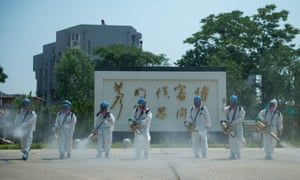 Members of the Beijing Blue Sky Rescue team conduct disinfection at the China Meat Food Research Center in Fengtai District of Beijing, capital of China, 21 June 2020.