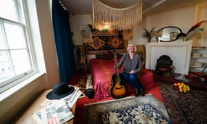 Kathy Etchingham, Jimi Hendrix's former girlfriend, poses in the bedroom of the London flat they once shared.