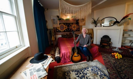 Kathy Etchingham, the former girlfriend of Jimi Hendrix, posing for photographs in his former bedroom, now a museum.