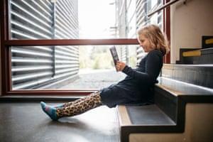 Second grader Menni Pietiläinen reads a book after official school hours.
