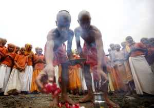 Priests perform a ritual during the festival