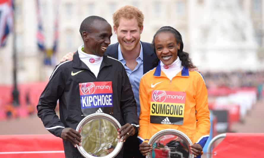 Prince Harry with Eliud Kipchoge and Jemima Sumgong after they won the men's and women's races.