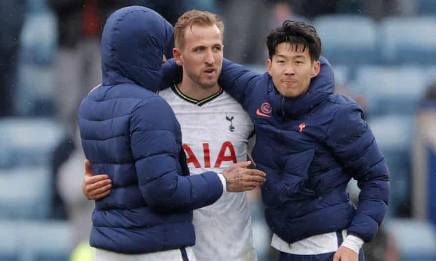 Harry Kane is embraced by Tottenham teammates at the end of what he hopes was his final appearance for the club.