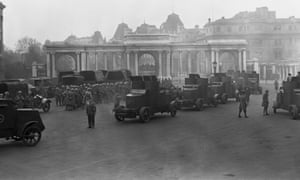 During the general strike in 1926, armoured cars and troops at Hyde Park Corner, London, prepare to escort London's great food convoy.