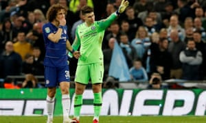 Chelsea's Kepa Arrizabalaga gestures to his manager that he is not going to come off during the League Cup final against Manchester City on Sunday.