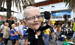 A protester dressed as Prime Minister Scott Morrison holding coal takes part in a rally on climate inaction outside the office of Prime Minister Scott Morrison in Cronulla, Australia, 3 May 2019.