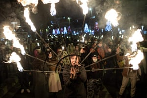 Protesters attend a torchlit procession in Nantes, France, to ask for the reopening of the cultural sector