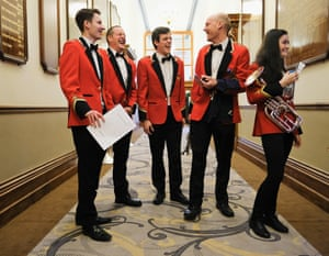 Members of Hade Edge brass band share a joke as they gather to register ahead of performing at Huddersfield Town Hall during the Yorkshire regional finals of the National Brass Band Championships of Great Britain