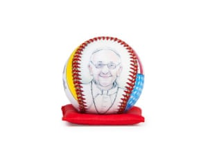 Pope Francis on a handcrafted decorative baseball on a commemorative red pillow