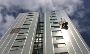 Cladding being removed from a tower block in Barnet.