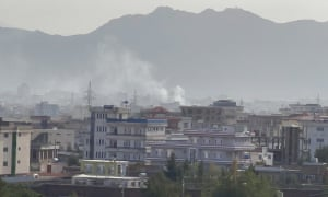 Smoke rises after an explosion in Kabul on Sunday.