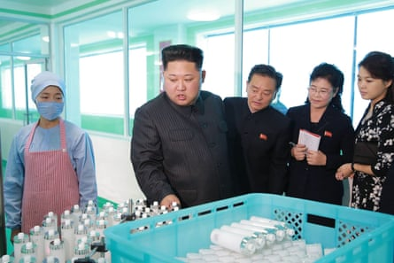 Kim inspects bottles at the factory.
