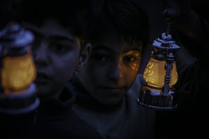 Idlib, Syria. Children hold donated hand lamps ahead of holy Islamic fasting month of Ramadan at a Al-Iman Refugee Camp