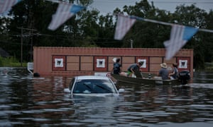 A car in flooded Gonzales, Louisiana during the Aegust floods