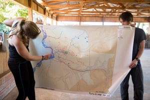 Cool Earth team members Hannah Peck and Martin Simonneau display a map showing tracks and pathways through the Amazon forest. The maps are made with the local community to identify areas of deforestation around the Cutivireni area.