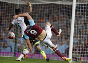 Andy Carroll attempts to cut the ball back under pressure from Rojo.