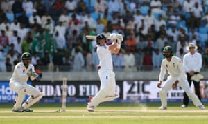England's Joe Root smashes the ball away as Pakistan's Sarfraz Ahmed looks on.