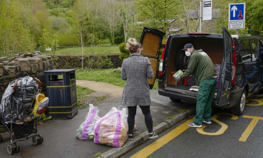 Volunteers help restock a community food bank in Carrbrook Village, Greater Manchester.