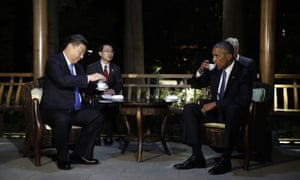 Barack Obama and Xi Jinping drink tea in a pavilion at West Lake State Guest House in Hangzhou in eastern China's Zhejiang province.