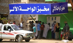 Residents of Khartoum queue in front of a bakery, on 9 April 2020, a day after the Sudanese authorities have announced a rise in the price of bread in the capital.