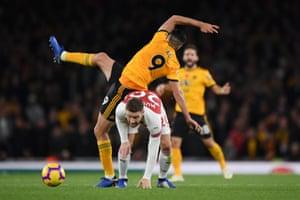 . 11 November: Arsenal's Shkodran Mustafi fights with Raul Jimenez of Wolverhampton Wanderers for possession.