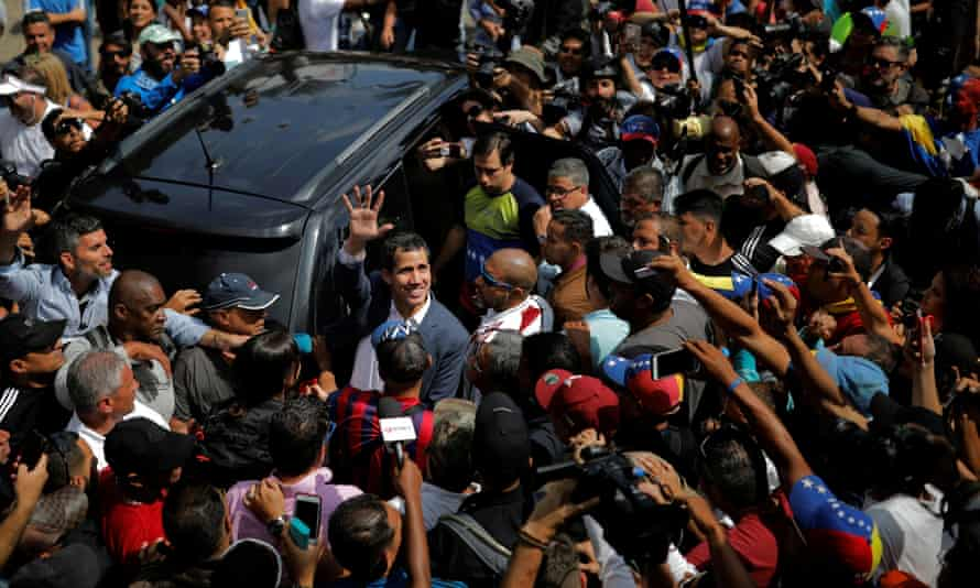 Juan Guaidó waves to supporters during a rally in Caracas.