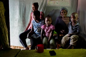 Rosemary with her grandchildren: Millicent, Velma, Mary, Owen, Ashley and Junior, inside their home in Kibera