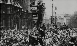 Winston Churchill is mobbed after his VE Day broadcast.