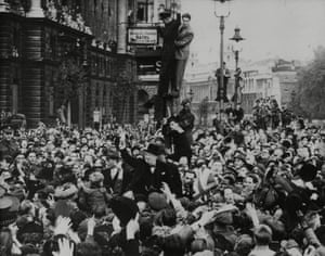 Prime Minister Winston Churchill is mobbed after his VE Day broadcast